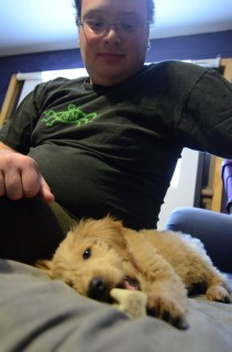 68 max looks down upon puppy.JPG